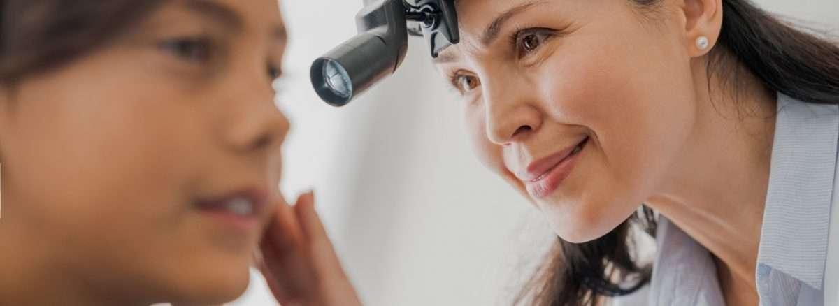 ent specialist examines patient